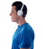 Side pose of a man with headphones — Stock Photo