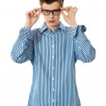 Young boy holding eyeglasses — Stock Photo #11225249