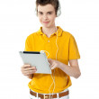 Smart boy using touch screen device — Stock Photo #11225254