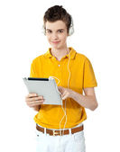 Smart boy using touch screen device — Stock Photo