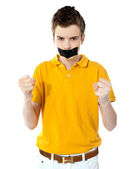 Angry boy with masking tape on mouth. — Stock Photo