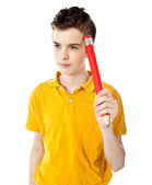 Thoughtful boy holding a pencil — Stockfoto