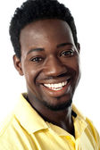 Closeup of smiling handsome african guy — Stock Photo