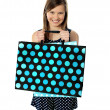 Teenager holding shopping bags - Stock Photo