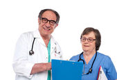 Senior doctors reading medical report — Stock Photo