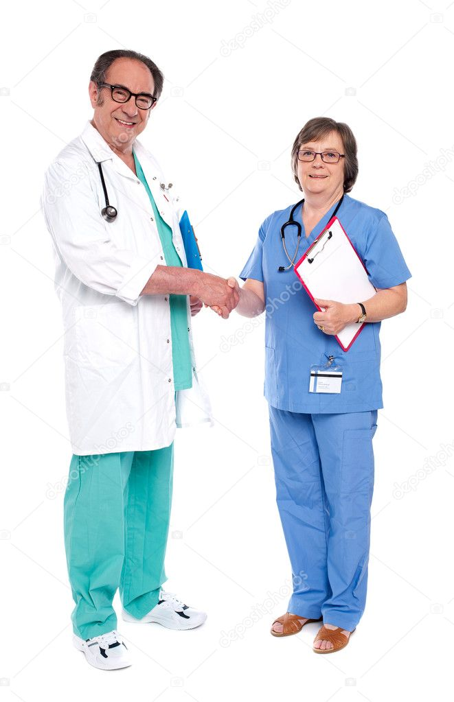 Full body portrait of two medical representatives shaking hands  Stock Photo #11421777