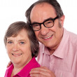 Closeup portrait of smiling aged couple — Stock Photo