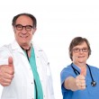 Medical professionals showing thumbs up — Stock Photo