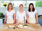 Group of young beautiful professional chefs — Stock Photo