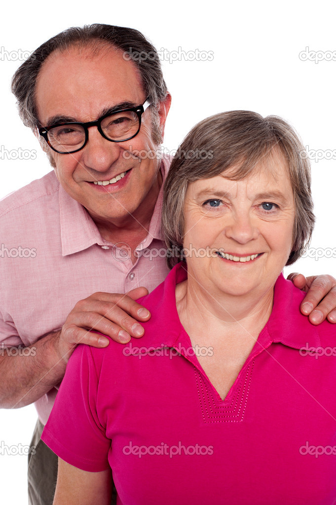 Closeup portrait of smiling matured couple. Man with hands on his wife's shoulder — Stock Photo #11506689