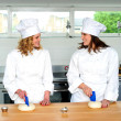Two female chefs looking at each other — Stock Photo