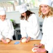 Female chefs at work in a restaurant kitchen — Stock Photo
