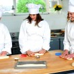 Beautiful female chefs kneading dough — Stock Photo