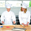 Senior chef teaching newbie female chef — Stock Photo