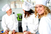 Group of professional female chefs — Stock Photo