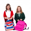 Pretty girls unzipping school bag — Stock Photo