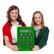 Girls showing big green calculator to camera — Stock Photo #11781631