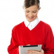 Happy young girl using tablet pc — Stock Photo #11781670