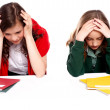 Confused students holding their heads — Stock Photo #11781685