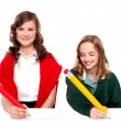 Cheerful girls writing with pencil on surface — Stock Photo #11781713