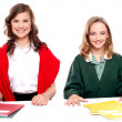 Portrait of teenager students with notebooks — Stock Photo