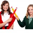 Smiling teenagers making cross sign with pencil — Stock Photo