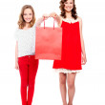 Beautiful teenagers holding shopping bag — Stock Photo