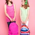 Beautiful teenagers holding school bag — Stock Photo