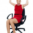 Excited woman sitting in chair. Isolated — Stock Photo #11782035
