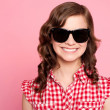 Trendy young girl in black goggles — Stock Photo