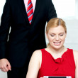 Boss operating tablet pc and assistant looking — Stock Photo #11782044