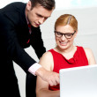 Business team in action. Man pointing at laptop — Stock Photo #11782047