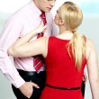 Woman pulling man from his tie. Feeling naughty — Stock Photo #11782068