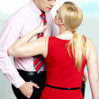 Woman pulling man from his tie. Feeling naughty — Stock Photo