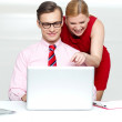 Lady pointing at something funny in laptop — Stock Photo