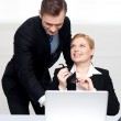 Business at work. Male pointing at laptop — Stock Photo