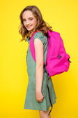 Pretty school girl carrying pink backpack — Stock Photo