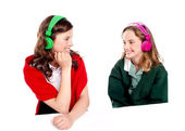 Pretty girls enjoying music. Looking at each other — Stock Photo