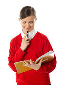 Girl thinking and looking into her notebook — Stock Photo