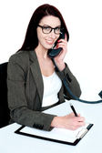 Corporate lady posing with telephone receiver — Stock Photo