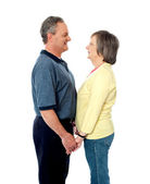 Aged couple in love holding hands — Stock Photo