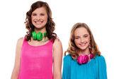 Teenagers posing with headphones around neck — Stock Photo