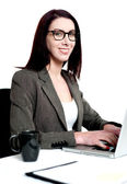 Beautiful businesswoman working on laptop — Stock Photo