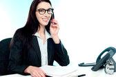 Female customer care executive holding mic — Stock Photo