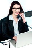 Female executive speaking on phone — Stock Photo