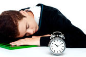 Tired schoolboy sleeping on calculator — Stock Photo