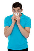 Young guy suffering from cold — Stock Photo