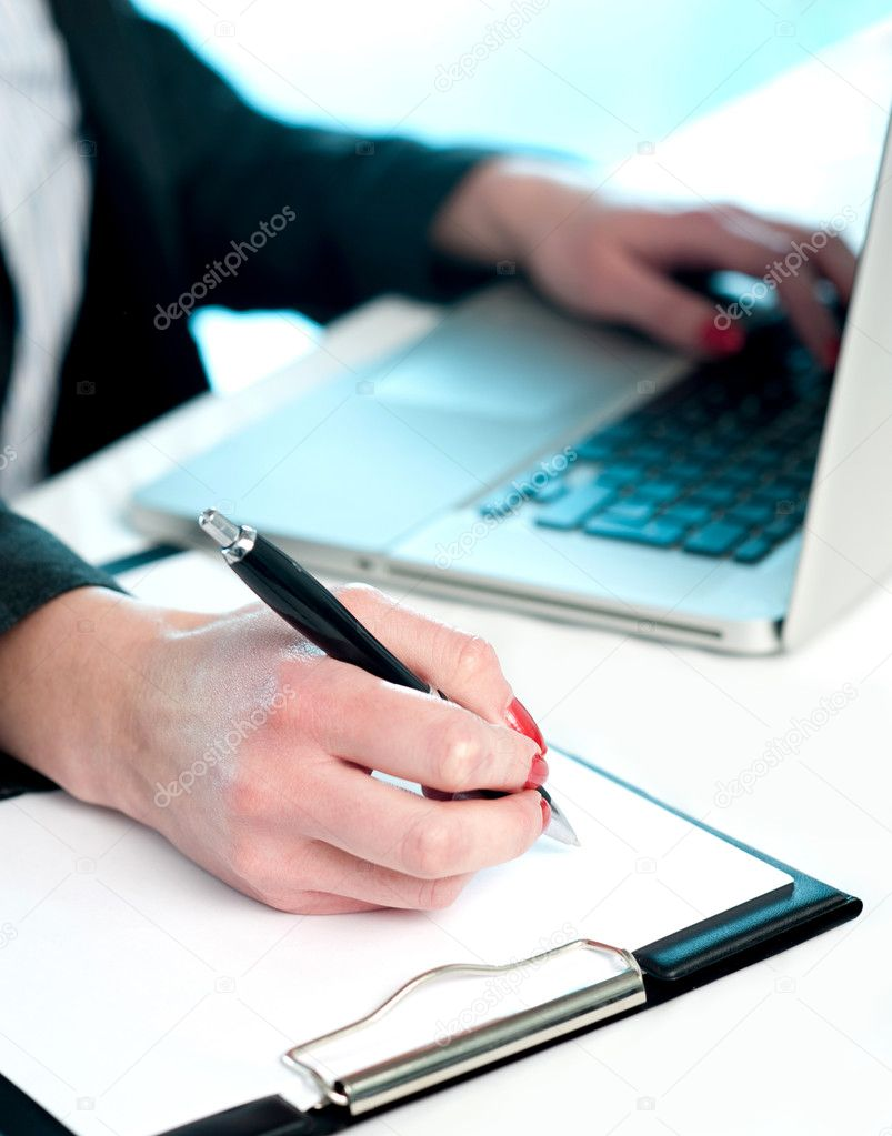 Closeup of woman copying data from laptop to notepad, Making important notes — Stock Photo #11782033