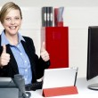 Stock Photo: Senior businesswoman gesturing thumbs up