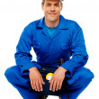 Foto Stock: Smiling male worker wearing safety hat